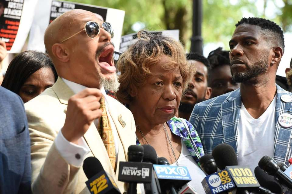 Gwen Garner, mother of Eric Garner, was applauding