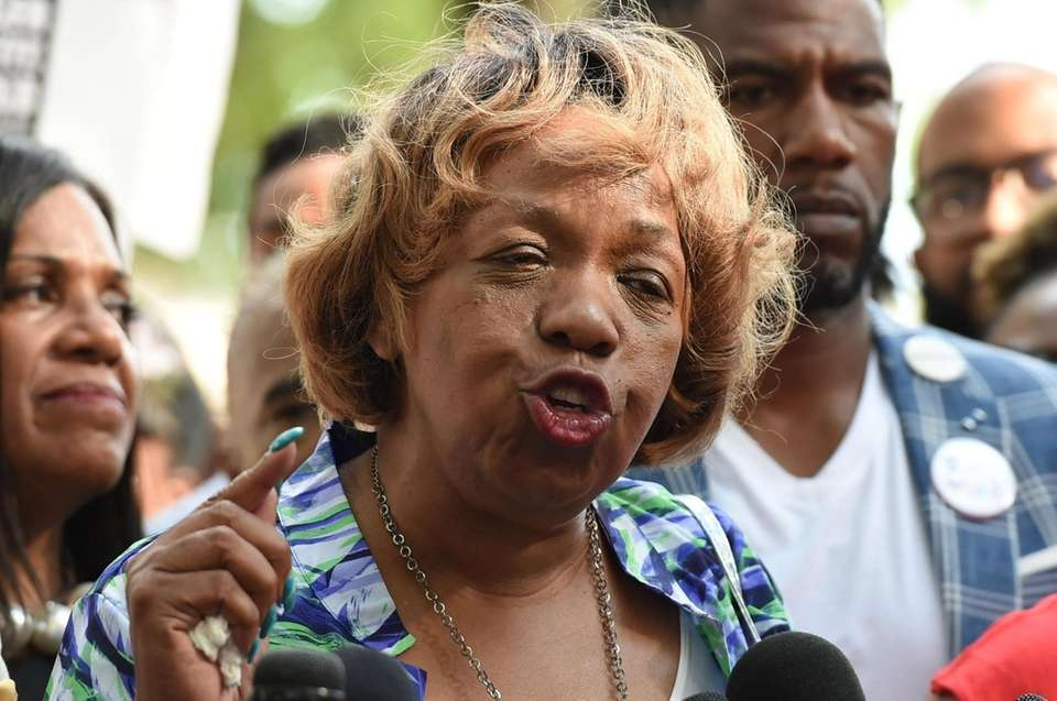 Gwen Carr, mother of Eric Garner, was applauding