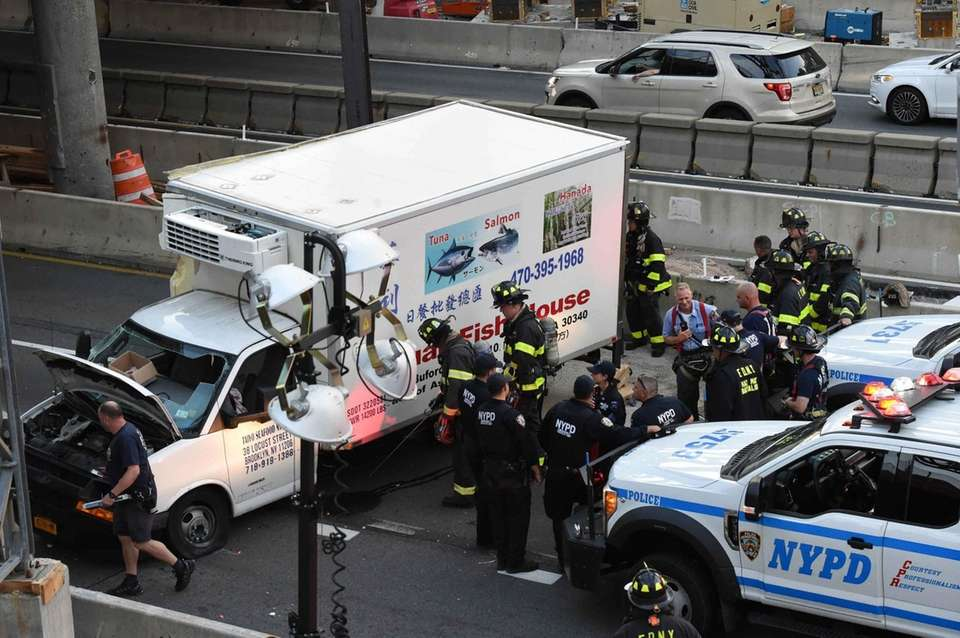 An overturned box truck on the Gowanus Expressway
