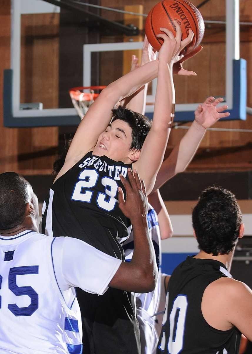 Solomon Schechter's Jacob Katz battles for a rebound