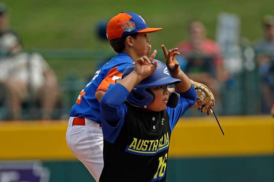 Australia's Lucas Gallardo celebrates hitting a double as