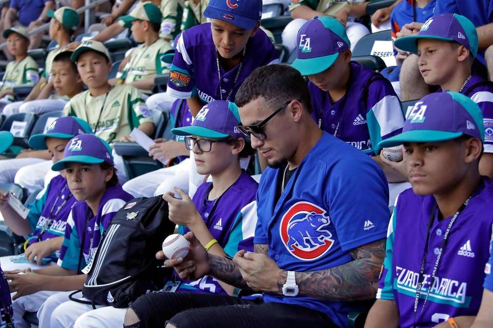 Chicago Cubs' Javier Baez signs autographs in the
