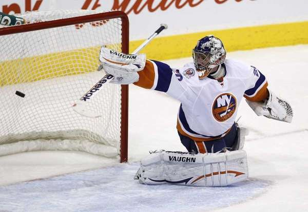New York Islanders goaltender Evgeni Nabokov gives up