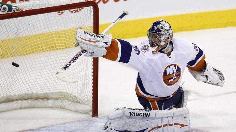 New York Islanders goaltender Evgeni Nabokov gives up