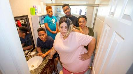 Dana Beard, center, with her three boys --