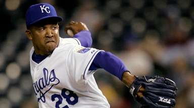 Then-Royals closer Octavio Dotel pitches during the ninth