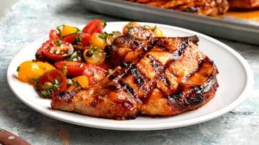 Grilled pork chops glazed with Sriracha and apricot