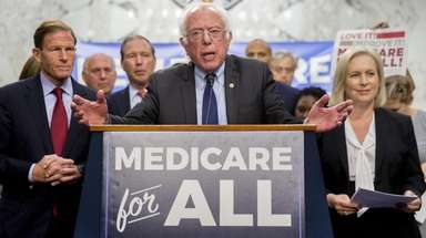 Sen. Bernie Sanders speaks during a health care
