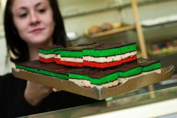 Michelle Russo holds a tray of rainbow cookies
