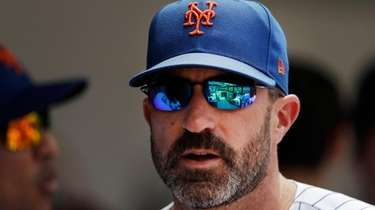 Mets manager Mickey Callaway watches from the dugout
