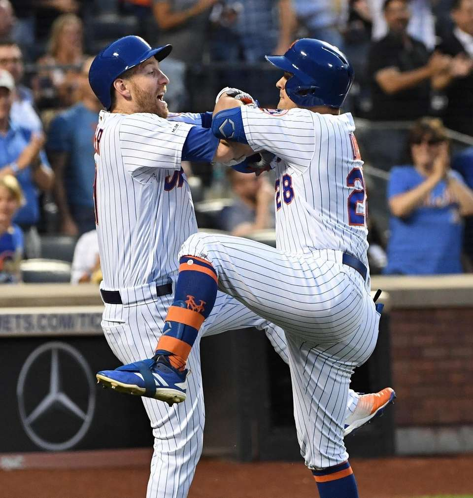 The Mets' Todd Frazier greets J.D. Davis after