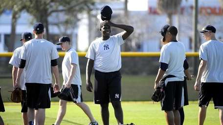 Michael Pineda, center, arrives at a morning practice