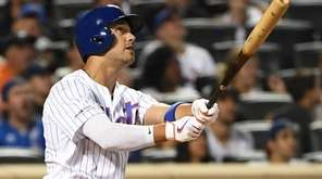 Mets rightfielder Michael Conforto watches the flight of