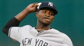 Yankees pitcher Domingo German delivers in the bottom