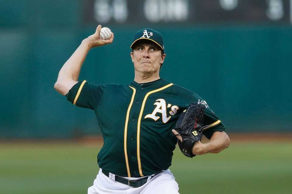 Athletics pitcher Homer Bailey delivers in the top