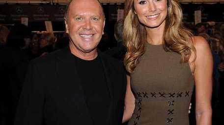 Michael Kors and model Stacy Keibler pose at