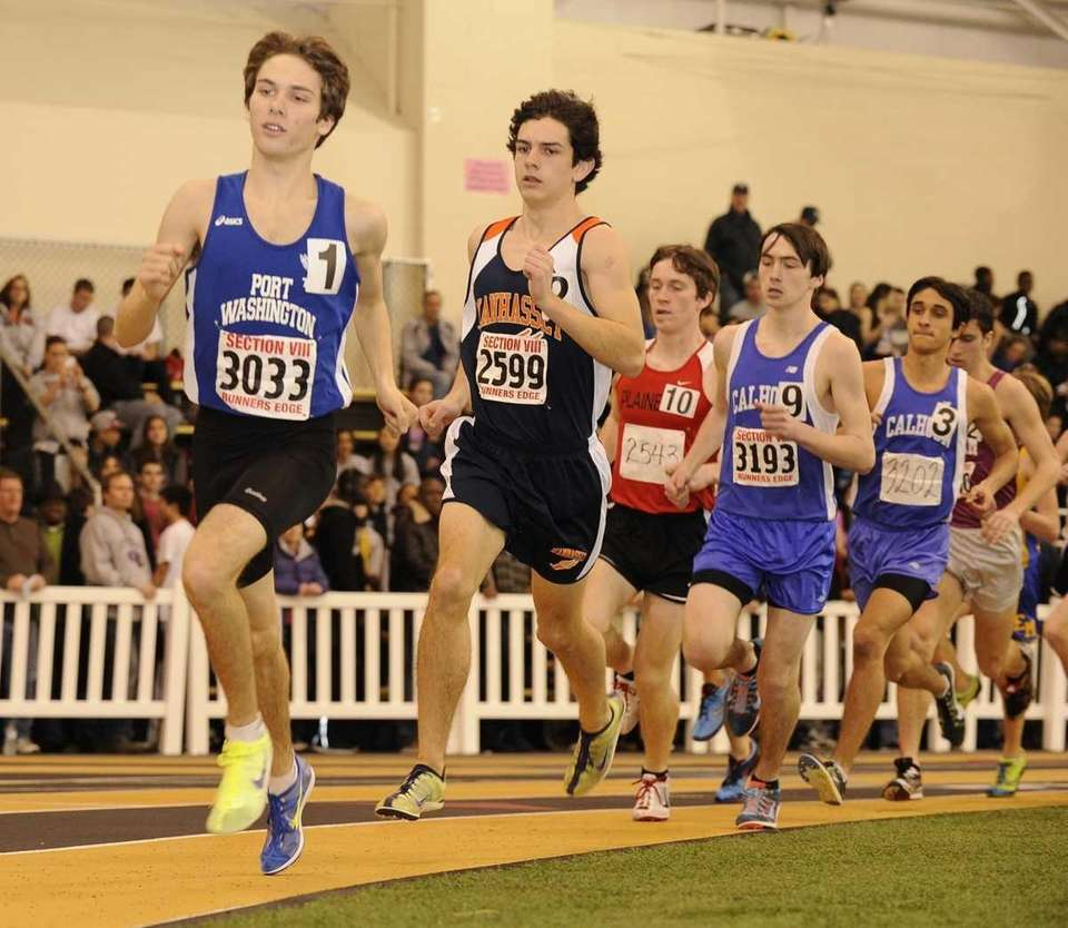 Runners race during the 3200 meter event in