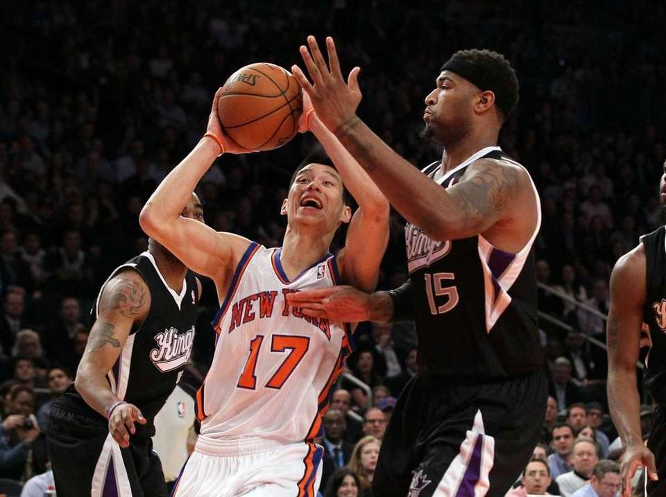 Jeremy Lin drives against DeMarcus Cousins of the