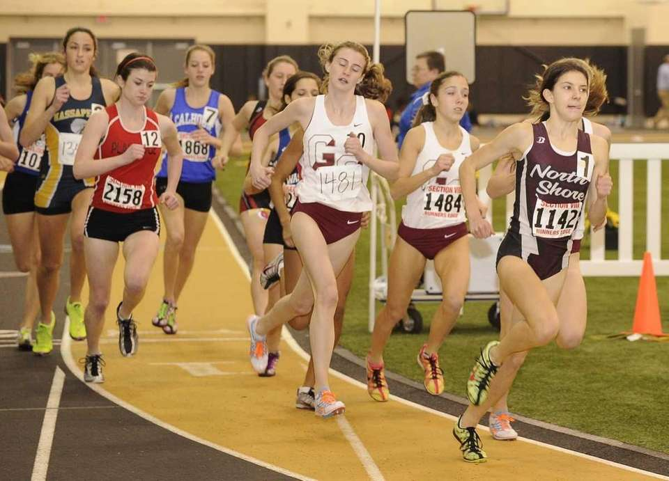 Runners race in the 1000 meter event in