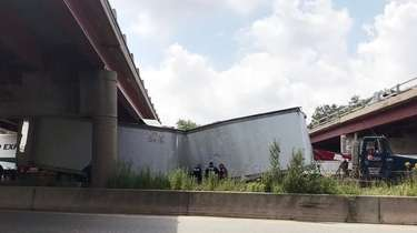 The tractor trailer under the overpass on Wednesday.
