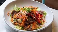 The popular BBQ beef salad, featuring red onion