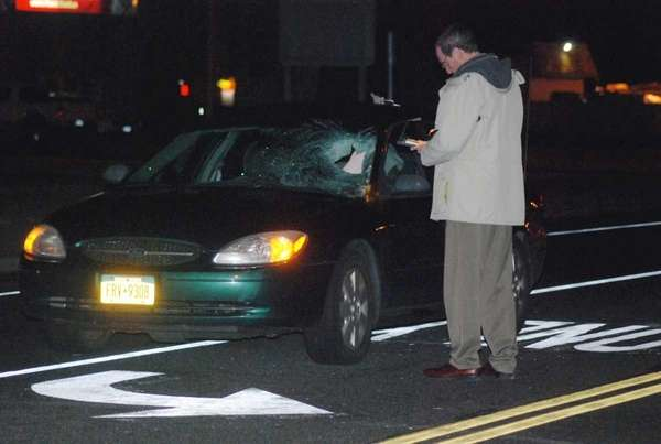 Suffolk County police investigate a pedestrian accident on