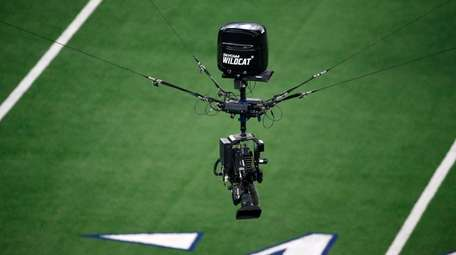 A Skycam WILDCAT is maneuvered over the field