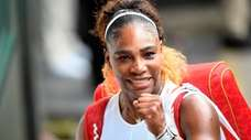 Serena Williams gestures as she leaves the court