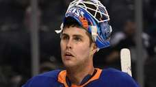 Islanders goaltender Thomas Greiss looks on against the