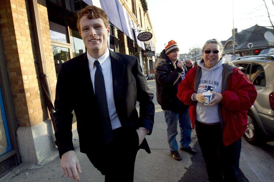 Joseph Kennedy III walks toward the Newton Center
