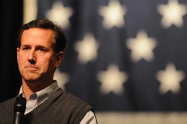 Republican presidential candidate Rick Santorum pauses for a