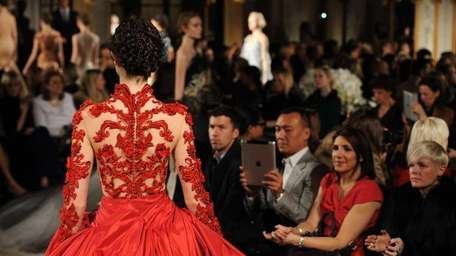 A model walks the runway at the Marchesa