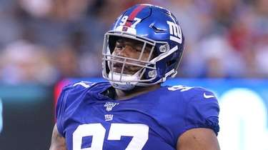 Giants defensive tackle Dexter Lawrence looks on during