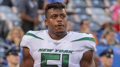 Jets outside linebacker Brandon Copeland looks on before
