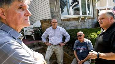 Nassau County Legislator Bill Gaylor, center, speaks with