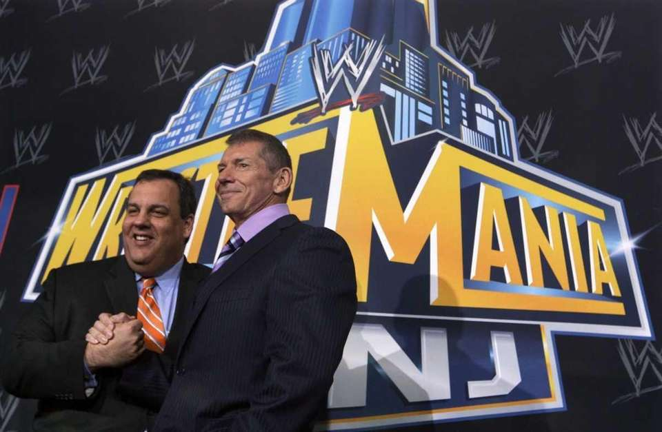Gov. Chris Christie stands with WWE chairman and