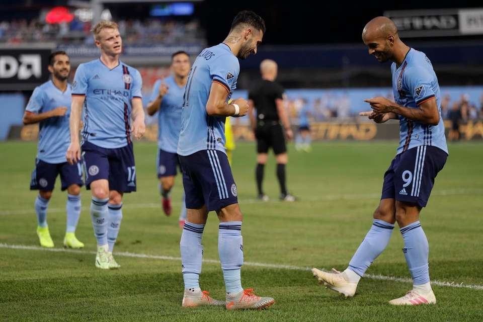 Teammates watch as New York City FC midfielder