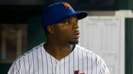 The Mets' Rajai Davis looks on during the
