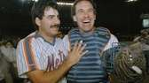 Keith Hernandez, left, and Gary Carter walk off