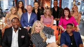 Christie Brinkley, front row, center, and Sean Spicer,