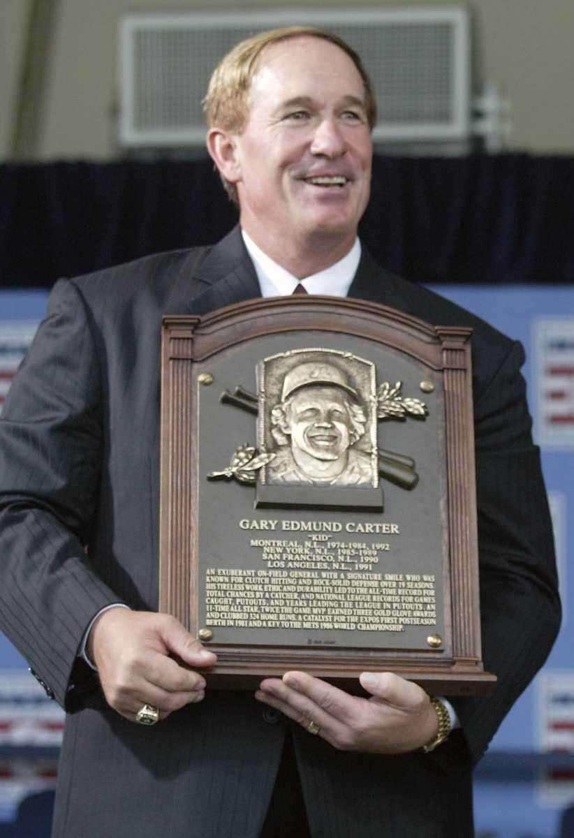Gary Carter holds his Hall of Fame plaque