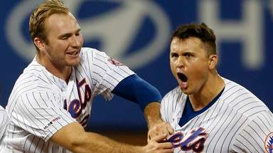 The Met's J.D. Davis celebrates his 10th-inning walk-off