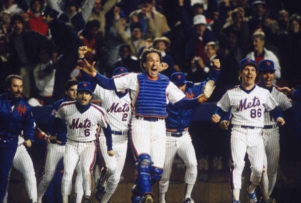 Catcher Gary Carter leads the cheers as the