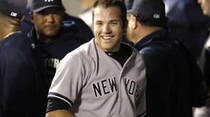 Yankees catcher Austin Romine smiles in the visitors'