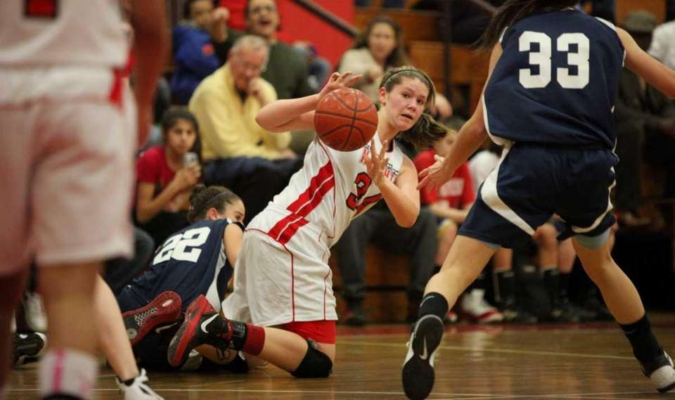 Floral Park's Lorraine Hickman, right, tries to maintain