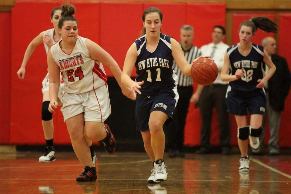 New Hyde Park's Shelby Platia, right, dribbles up