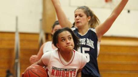 Floral Park's Kaela Hilaire, left, drives past New