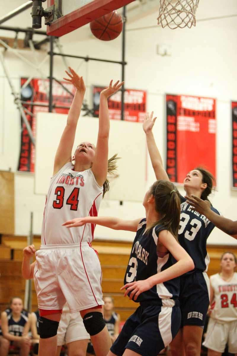 Floral Park's Lorraine Hickman goes for a lay-up