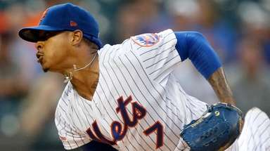 Mets starter Marcus Stroman delivers during the first