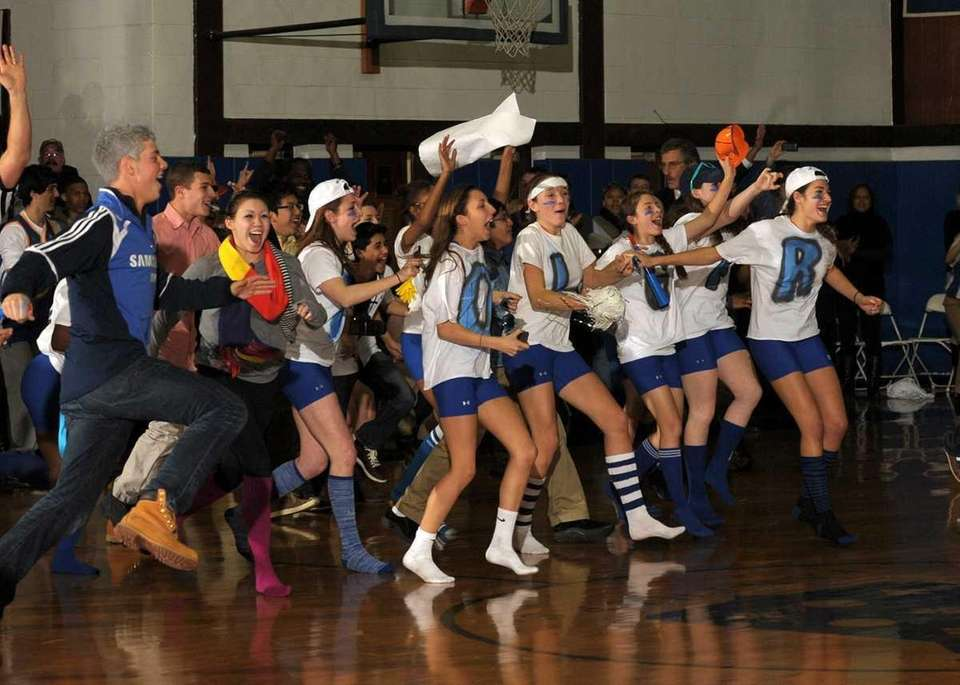 Portledge fans and students rush the court as